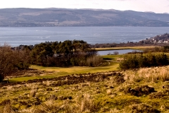 Up on the moor looking down on the 6th green and 7th tee.
