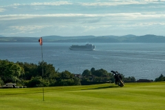 The 5th green and a cruise ship from Greenock heading out to sea.