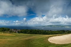 Looking over the corner of the 5th greens bunker westward to the Isle of Bute.