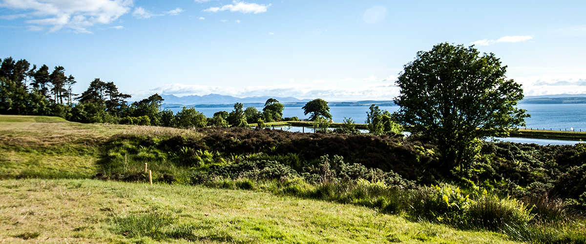 Over the rough to the right of the 13th and out beyond the Clyde estuary.
