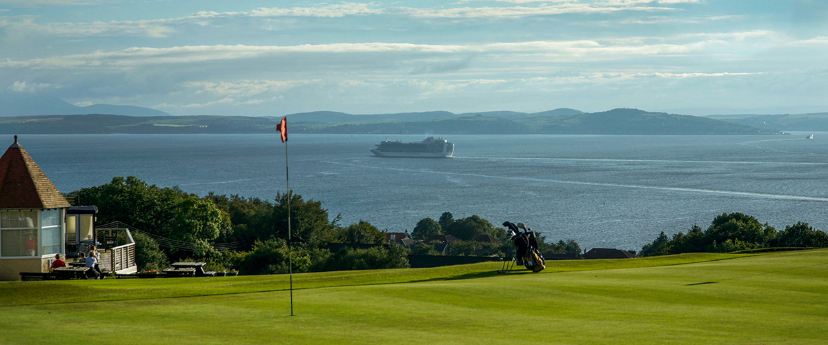 5th green and a cruise ship heading out to sea.
