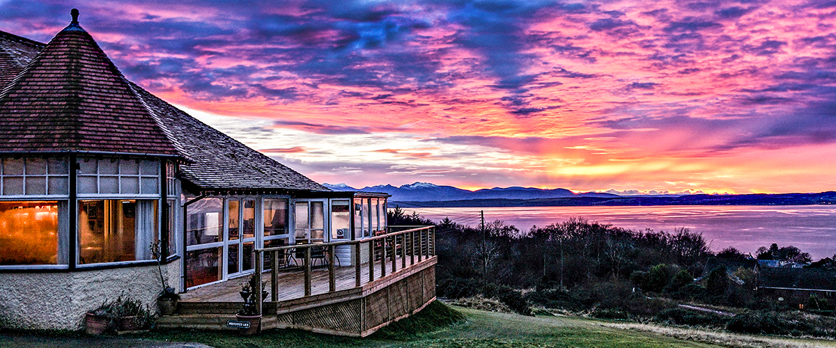The clubhouse balcony and a stunning summer sunset.