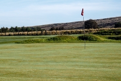 The 18th green looking eastwards to the rising moor.